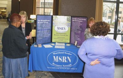 Deb Bakalich, left and Patti Farrell, right, talking with people at the MSRN table
